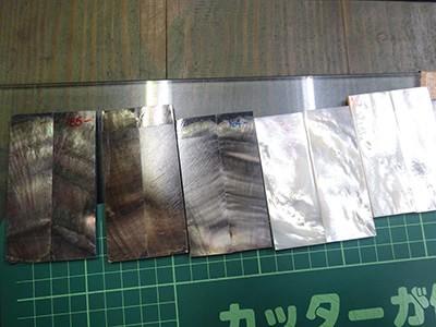 ハンドルの材料 貝の白いパールと黒いパール